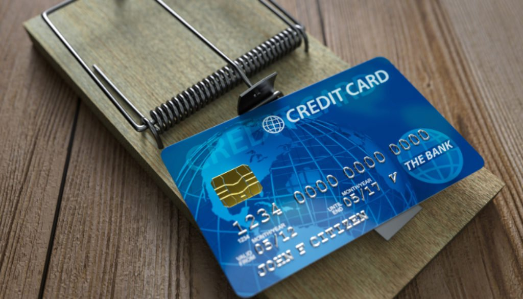 A credit card sitting on a mousetrap.